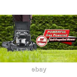 22Gas Self Propelled Walk Behind LawnMower Large Rear Wheels Rolling Over Bumpy